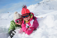Happy children enjoying winter holidays in snowy mountains Royalty Free Stock Photos