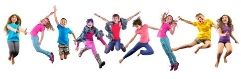 Happy children exercising and jumping over white. Large group of happy children exercising, jumping and having fun. Isolated over white background. Childhood stock photography