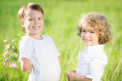 Happy children with flowers Royalty Free Stock Image