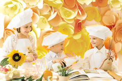 Happy  children in the form of a chef to prepare delicious. Happy little children in the form of a chef to prepare delicious Stock Photography