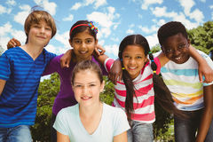 Happy children forming huddle at park royalty free stock photo
