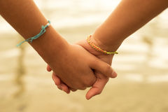 Happy children friends hold hands in summertime Stock Photography