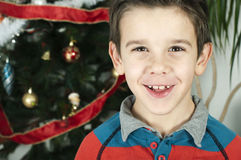 Happy children in front of Christmas tree Royalty Free Stock Photo