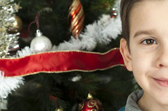 Happy children in front of Christmas tree Stock Photo