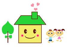 Happy children in front of his house Royalty Free Stock Photo