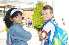 Happy children in front of the school, outdoor. Summer to fall Royalty Free Stock Image