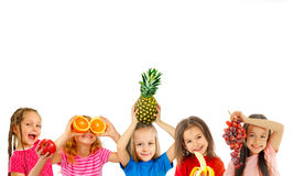 Happy children with fruits Royalty Free Stock Photography