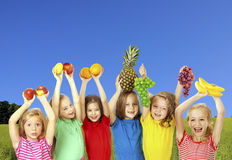Happy children with fruits Stock Images