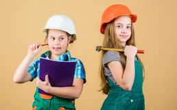 Happy children. Future career. Labor day. 1 may. Little kids in helmet with tablet and hammer. Foreman inspector. Repair stock images