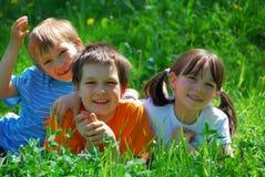 Happy children in garden stock images