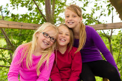 Happy children in the garden and laugh Stock Image