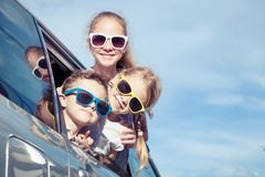 Happy children getting ready for road trip on a sunny day Stock Images