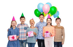 Happy children with gifts on birthday party Royalty Free Stock Photography