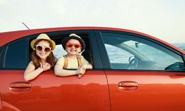 Happy children girl and boy goes to summer travel trip in car. Happy children girl and boy goes to summer travel trip in the car royalty free stock photos