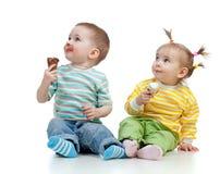 Happy children girl and boy with ice cream stock photo