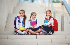 Happy children girlfriend schoolgirl student elementary school. Happy children girls girlfriend schoolgirl student elementary school royalty free stock photo