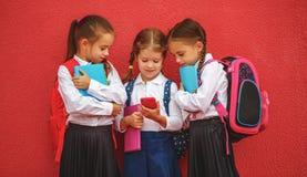 Happy children  girlfriends schoolgirls student elementary schoo Royalty Free Stock Photography