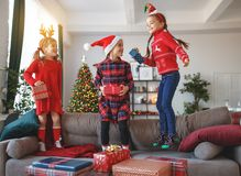 Happy children girls with christmas gifts near tree in morning royalty free stock images