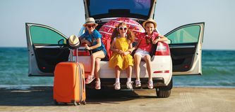 Happy children girls friends sisters on the car ride to summer trip. Happy children girls friends sisters on the car ride to the summer trip stock image