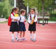 Happy children girlfriend schoolgirl student elementary school Stock Images