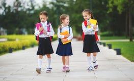 Happy children  girlfriend schoolgirl student elementary school Royalty Free Stock Photos