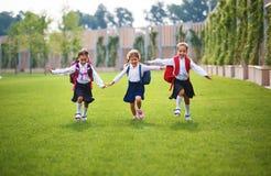 Happy children  girlfriend schoolgirl student elementary school Stock Image
