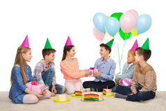 Happy children giving presents at birthday party Stock Photos