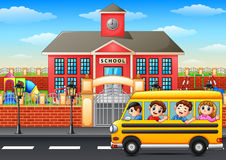 Happy children going to school with school bus Royalty Free Stock Photos