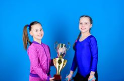 Happy children with gold champion cup. team victory. Sport success. Acrobatics and gymnastics. Little girls hold jump. Rope. victory of teen girls. Winners in royalty free stock photos