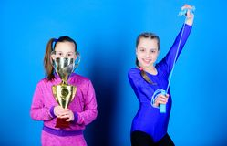 Happy children with gold champion cup. victory of teen girls. Winners in competition. Acrobatics and gymnastics. Little. Girls hold jump rope. Sport success royalty free stock images