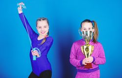 Happy children with gold champion cup. victory of teen girls. Winners in competition. Acrobatics and gymnastics. Little. Girls hold jump rope. Sport success stock photography