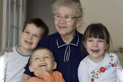 Happy children with grandma Stock Photo
