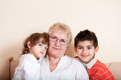 Happy children with grandmother Stock Photos