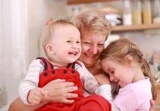 Happy children with granny royalty free stock photo