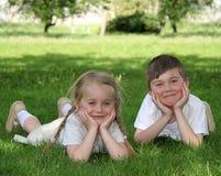 Happy children on the grass Stock Photos