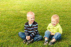 Happy children on green grass Royalty Free Stock Image