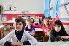 Happy children group in school Royalty Free Stock Image
