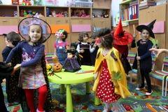 Happy children on Halloween. Children celebrating Halloween at kindergarten in Bucharest,Romania royalty free stock images