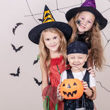 Happy children on Halloween party. Happy brother and two sisters on Halloween party Royalty Free Stock Photos