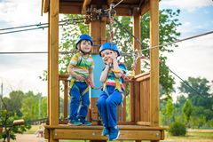 Happy children having fun in adventure park stock images