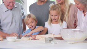 Happy children having fun baking stock footage