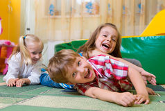 Happy children having fun at home Stock Images