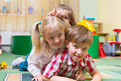 Happy children having fun at home Royalty Free Stock Image