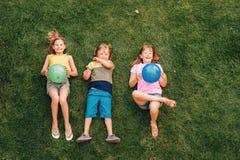 Happy children having fun outdoors stock images