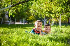 Happy children having fun outdoors. Kids playing in summer park. royalty free stock images