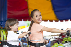 Happy children having fun riding Royalty Free Stock Image