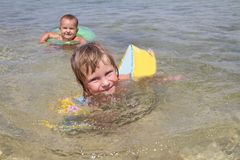 Happy children having fun in water Royalty Free Stock Photo