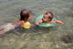 Happy children having fun in water Stock Images