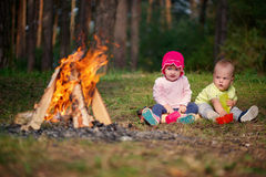 Happy children hiking in the forest Stock Photos