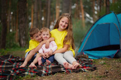 Happy children hiking in the forest Stock Images